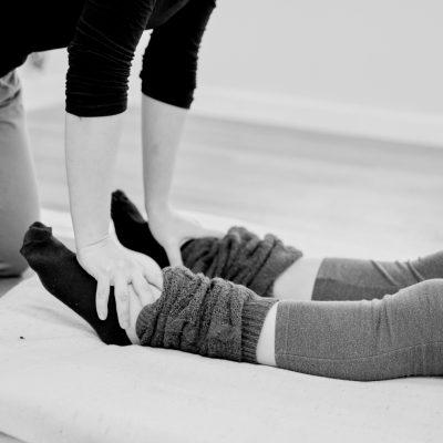 Woman receiving a Thai massage on her feet
